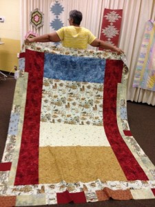 Kat shows the back of her quilt, facing the Delectable Mountains she demonstrated.